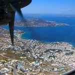Forget JFK, fly JMK! Mykonos Greece windy landing with an ATR 72 turboprop by Astra airlines. Before your flight booking, note that there is no public bus transport, only taxis.