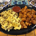 La Hacienda in A has a nice breakfast (beyond just eggs and bacon) if you have a longer layover in the morning. Quick and friendly service.