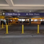 Uber picks up in the Valet area which is across from Terminal 3 in the Parking garage. Take the skybridge over and then down to Level 2.