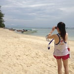 Photo taken at Watercolours Resort & Dive Centre by Amily L. on 5/25/2013