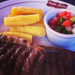 Photo taken at Santa Brasa Authentic Steaks by Élida D. on 7/9/2013