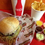 Photo taken at Junior Colombian Burger by Angela on 11/30/2012