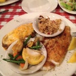 Photo taken at Mulate's Cajun Restaurant by Dwade G. on 5/30/2012