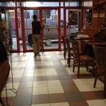 Photo taken at Café Bonjour Deli & Pizza by Terri N. on 2/27/2012