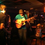 Photo taken at Tanqueray's Bar & Grille by Lauren S. on 2/14/2012