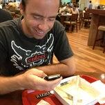 Photo taken at Rizzo Italian Gourmet by Paulo B. on 4/10/2013