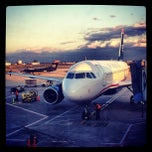 Photo taken at Gate C14 by Manny G. on 3/25/2013
