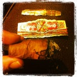 Photo taken at Vitola Fine Cigars by Harris S. on 12/13/2013