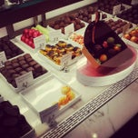 Photo taken at Godiva Chocolatier by Dwayne K. on 10/18/2013