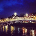 Photo taken at The Ha'penny (Liffey) Bridge by Aga P. on 1/27/2013