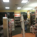 Photo taken at Payless ShoeSource by Russell A. on 3/31/2013