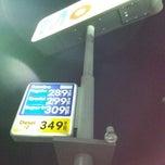 Photo taken at Mobil by Juan H. on 12/23/2014