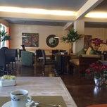 Photo taken at Sena 22 Restaurante by Luis M. on 1/25/2014