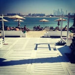 Photo taken at Nasimi Beach by Hasret D. on 2/9/2013