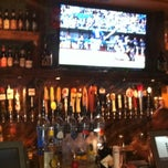 Photo taken at The Lodge Beer and Growler Bar by Neil Travis H. on 5/25/2013