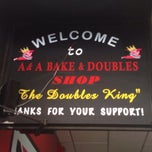 Photo taken at A & A Bake & Doubles by Jay B. on 7/21/2014