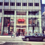 Photo taken at Uniqlo 5th Ave by Kenichi S. on 4/25/2013