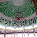 Photo taken at Masjid Agung Al-Falah by Kelvin R. A. on 7/31/2014