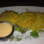 Photo taken at OPUS Restaurant by Chanda M. on 10/14/2012