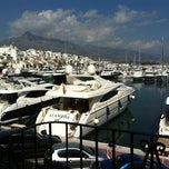 Photo taken at Puerto Banús by Anastasiya Y. on 10/1/2012