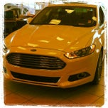 Photo taken at Bill Currie Ford (Show Room) by DJ Tone on 3/12/2013