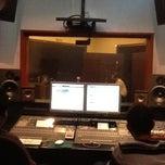 Photo taken at Amerasian Studio by Guia F. on 6/12/2013