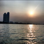 Photo taken at Ancol Beach by Ewo P. on 10/7/2012