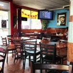 Photo taken at Rubens Cafe by Rolando E. on 4/3/2013