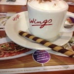 Photo taken at Wings by Paola on 10/15/2013