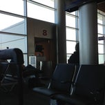 Photo taken at Gate 8 by Damacio U. on 4/29/2013