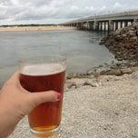 Photo taken at Matanzas Inlet Under The Bridge On The Beach by Cari on 9/22/2013
