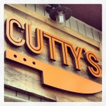 Photo taken at Cutty's by laura f. on 5/15/2013