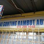 Photo taken at Kedai Gunting Rambut by BaRt L. on 9/1/2013