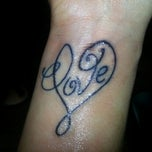 Photo taken at Sin Alley Tattoo by Christian N. on 1/27/2013
