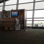 Photo taken at Gate A23 by Jiaxin L. on 4/16/2013
