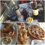 Photo taken at Trattoria Italian Kitchen by Desmond C. on 7/6/2013