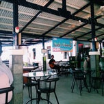 Photo taken at Cafe Pisang by della a. on 1/10/2015