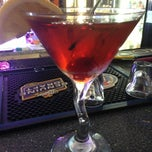 Photo taken at Pizza Como/Lou's 50 Yard Line Sports Bar by Crystal C. on 3/31/2014