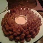 Photo taken at Outback Steakhouse by Leah S. on 12/25/2012