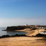 Photo taken at Praia de Vila Nova de Milfontes by Smmac on 3/11/2012