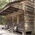 Photo taken at Hewn-Timber Slave Cabins by Larry F. on 11/12/2013
