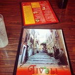 Photo taken at Tivoli Pizza by Jessy S. on 11/27/2012