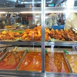Photo taken at Original Kayu Nasi Kandar Restaurant by Azylia A. on 2/12/2013