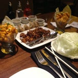 Photo taken at P.F. Chang's Asian Restaurant by Yali L. on 2/18/2013