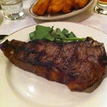 Photo taken at Gallaghers Steakhouse by Maurizio M. on 1/4/2013