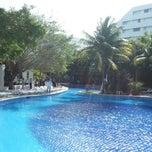 Photo taken at Oasis Palm Beach Resort by Sâmia M. on 3/14/2013