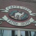 Photo taken at Camel City Tattoo Shoppe by Ryan F. on 1/25/2013