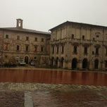 Photo taken at Piazza Grande by Rosangela N. on 3/26/2013