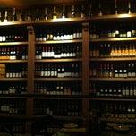 Photo taken at Swizz Restaurant & Wine Bar by Anne S. on 3/9/2013