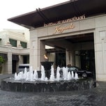 Photo taken at Siam Kempinski Hotel Bangkok by Duang S. on 8/1/2012